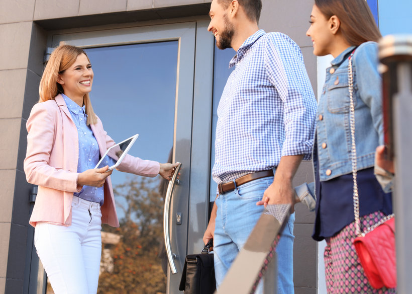 Female real estate agent welcoming healthcare professionals