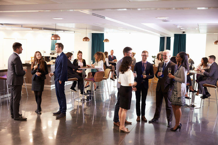 Group of Professionals Networking At Reception