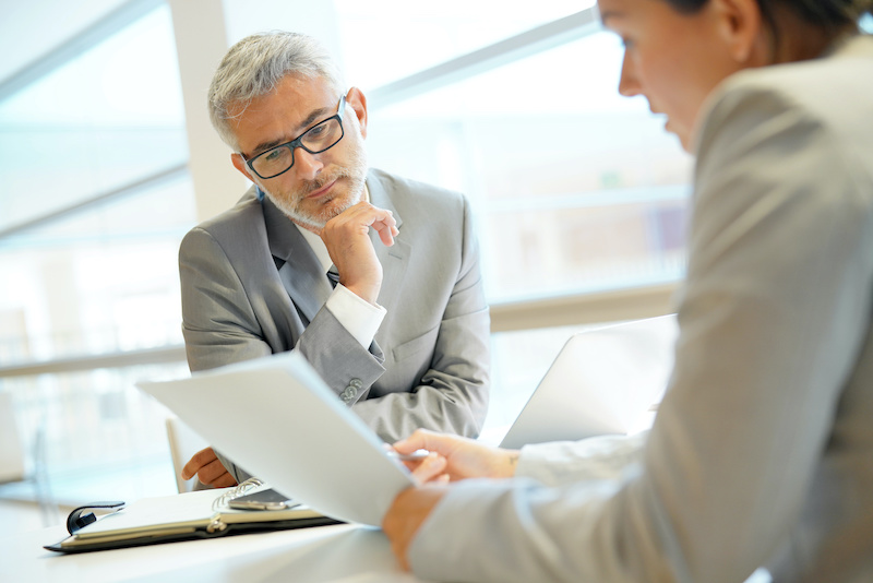two business professionals discussing commercial real estate lease